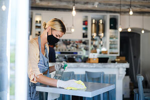 coffee-shop-woman-owner-working-with-face-mask-and-485K6XZ