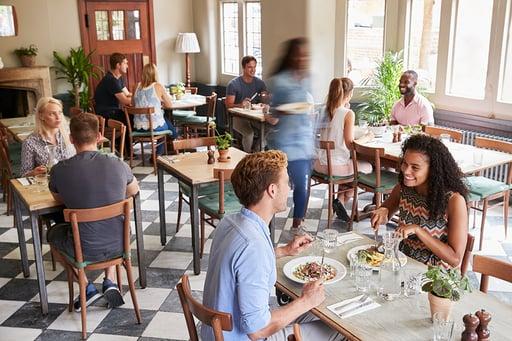 customers-enjoying-meals-in-busy-restaurant-BUNGX36_sm