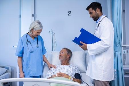 doctor-and-nurse-examining-a-patient-WJ532CG_sm