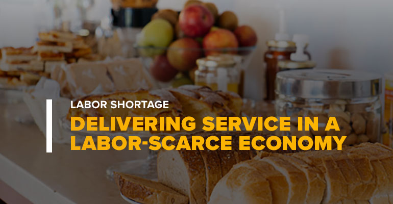 Hotel Dining Room With Text Labor Shortage: Delivering Service In A Labor-Scarce Economy