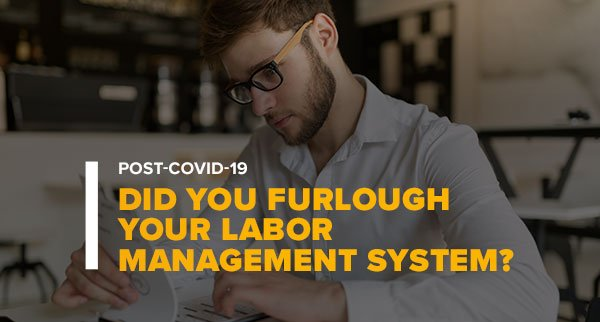 Man Reviewing Product Charts With Text: Post-Covid-19 Did You Furlough Your Labor Management System?