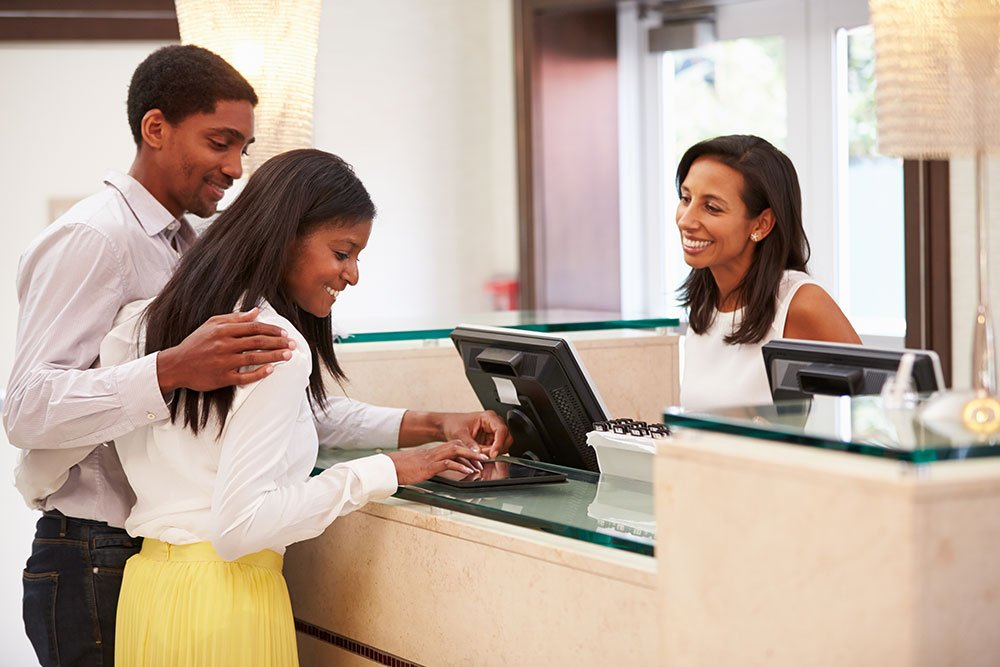 Couple Taking A Guest Satisfaction Survey At A Hotel
